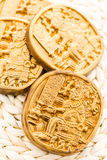Maya glyphs. Gourmet Maya glyphs in dark chocolate covered with gold dusting Royalty Free Stock Photography