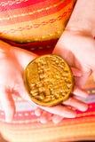 Maya glyphs. Gourmet Maya glyphs in dark chocolate covered with gold dusting Royalty Free Stock Photos
