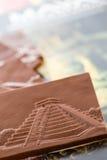 Maya glyphs. Gourmet Maya glyphs in milk chocolate Royalty Free Stock Images