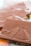Maya glyphs. Gourmet Maya glyphs in milk chocolate Stock Image