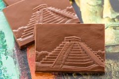 Maya glyphs. Gourmet Maya glyphs in milk chocolate Royalty Free Stock Image