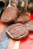 Maya glyphs. Gourmet Maya glyphs in milk chocolate Stock Photography