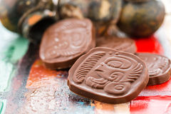 Maya glyphs. Gourmet Maya glyphs in milk chocolate Royalty Free Stock Photo