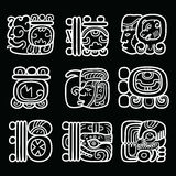 Maya glyphs, writing system and language vector design on black background. Mayan hieroglyphic script white design isolated on black Royalty Free Stock Photos