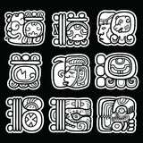 Maya glyphs, writing system and languge  design  on black background. Mayan hieroglyphic script white design isolated on black Royalty Free Stock Photography