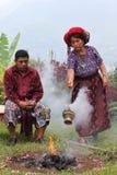 Maya priests performing ritual. Maya priests in Guatemala, performing offering ceremony near Santiago Atitlan Royalty Free Stock Photo