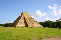 Maya pyramid. Antique mayan pyramid on green field over blue sky stock photo