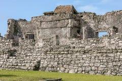 Maya ruins visit at Tulum. At Tulum in Yucatan, you can combine visit to Maya ruins and sand beach pleasure royalty free stock image