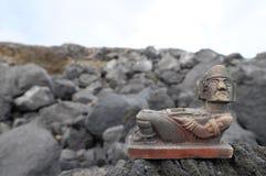 Maya Statue. Ancient Maya Statue on the Rocks near Ocean Stock Image