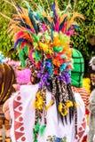 Maya warrior in parade of cartoon characters, Guatemala stock photos
