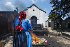 Maya woman performing a traditional mayan ritual in the cemetery of the town of Chichicastenango, in Guatemala Royalty Free Stock Images