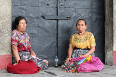 Maya women. In Guatemala antigua, in the streets in front of a church Stock Image