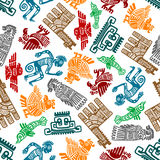 Mayan and aztec tribal totems seamless pattern. Seamless mayan and aztec totems pattern with colorful symbols of birds, idols, fish, shamans and lamas in tribal Royalty Free Stock Photo