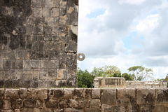 Mayan Ball Hoop. A side view of a Mayan ball court, showing perfect lines of construction and the ball hoop, in Chichen-Itza, Mexico Royalty Free Stock Images