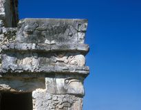 Mayan building-male head in profile. Mayan glyphs and decoration carved into the corner of a  building Stock Photos
