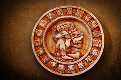 Mayan calendar. A carved Mayan calendar on textured background Royalty Free Stock Image