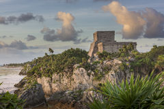 Mayan Castillo at Sunrise. The ancient ruin of a Mayan castle sitting on a cliff overlooking the beach at Tulum, Mexico Royalty Free Stock Photography