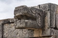 Kukulkan head detail showing fangs and tongue. This mayan deity, the feathered Snake, joins heaven and earth twice a year on Spring and autumn equinox stock images