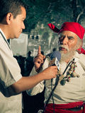 Mayan Elder Interview - Tikal, Guatemala Royalty Free Stock Photos