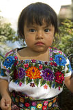 Mayan girl dressed in traditional embroidered costume. In the main square of Antigua, Guatemala Royalty Free Stock Image