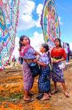 Mayan girls & giant kites, All Saints' Day, Guatemala. Santiago Sacatepequez, Guatemala - November 1, 2010: Mayan girls in traditional costume. Locals display Royalty Free Stock Image
