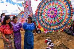 Mayan girls & giant kites, All Saints' Day, Guatemala. Santiago Sacatepequez, Guatemala - November 1, 2010: Traditionally dressed Mayan girls walking among Royalty Free Stock Image