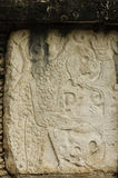 Mayan glyphs on a stone stele Stock Image