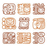 Mayan glyphs, writing system and language  design. Mayan hieroglyphic script brown design isolated on white Royalty Free Stock Photography