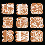 Mayan glyphs, writing system and languge  design in brown. Maya hieroglyphic script design isolated on black background Royalty Free Stock Photos
