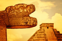 Mayan Head Sculpture in Chichen Itza Stock Photo