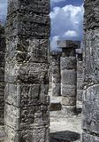 Mayan hieroglyphs. On stone columns [stelae], ancient temple at Chichen ItzaYucatan,Mexico Royalty Free Stock Photography