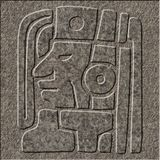 Mayan relief chiseled in granite. A mayan idol chiseled as a relief in granite royalty free stock photo