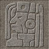 Mayan relief chiseled in granite. A mayan idol chiseled as a relief in granite royalty free stock photos