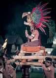 Mayan man in costume - Tikal, Guatemala. Man dressed in traditional Mayan costume being carried on a platform at the 2012 new year celebrations at Tikal in Royalty Free Stock Photography
