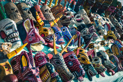 Mayan masks at a market stall in Panajachel, Guatemala Stock Photos