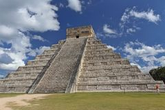 Mayan people architecture. Temple of Kukulkan in Chichen Itza on the background of blue sky stock image