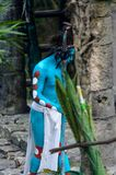 Mayan people in Mexico. XCARET, MEXICO - NOV 8, 2015: Unidentified man with a blue bodypaint as a Maya indian. Maya people are a group of Indigenous people of Royalty Free Stock Photos