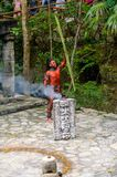 Mayan people in Mexico. XCARET, MEXICO - NOV 8, 2015: Unidentified man with a red bodypaint as a Maya indian. Maya are a group of Indigenous people of Stock Image