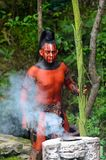 Mayan people in Mexico. XCARET, MEXICO - NOV 8, 2015: Unidentified man with a red bodypaint as a Maya indian. Maya are a group of Indigenous people of Stock Photo