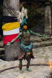 Mayan people in Mexico. XCARET, MEXICO - NOV 8, 2015: Unidentified man wears a costume of a Maya indian and dances. The Mayan are a group of Indigenous people of Stock Image