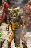Mayan people in Mexico. XCARET, MEXICO - NOV 8, 2015: Unidentified man wears a costume of a Maya indian and takes the attack position. The Mayan are a group of Royalty Free Stock Photo