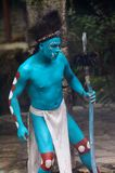 Mayan people in Mexico. XCARET, MEXICO - NOV 8, 2015: Unidentified man with the blue body paint dressed as the Maya indian. The Mayan are a group of Indigenous Stock Photos