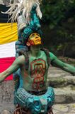 Mayan people in Mexico. XCARET, MEXICO - NOV 8, 2015: Unidentified man wears a costume of a Maya indian and dances. The Mayan are a group of Indigenous people of Stock Photography