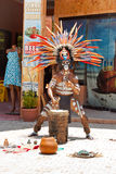 Mayan playing on drums. TULUM, MEXICO - JULY 15: Unidentified man in Mayan traditional ornamental feather headdress playing on drums to the ritual pleased the Stock Images
