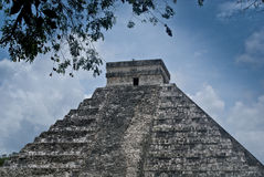 Mayan pyramid in Chichen Itza with blue sky and clouds Royalty Free Stock Photo
