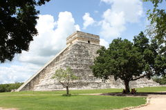Mayan Pyramid in Chichen-Itza Mexico. Daytime three quarter view of the Mayan pyramid in Chichen-Itza, Mexico, framed by trees Royalty Free Stock Photography