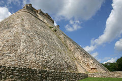 Mayan pyramid at Uxmal, Mexico. The long tiers of pyramid of the magician, Uxmal - Mexico Stock Image