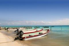 Mayan Riviera Mexico Puerto Morelos boats. Mayan Riviera Mexico Puerto Morelos beach boats turquoise Caribbean sea Stock Photos
