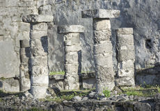 Mayan Ruins near Tulum, Mexico. Four ancient stone columns and capitals from the ruins of a Mayan house near Tulum, Mexico Stock Images