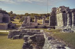 The Mayan ruins in the Tulum complex. Remains of ancient temples and buildings dating back to the Mayan civilization in Tulum, Mexico royalty free stock photos